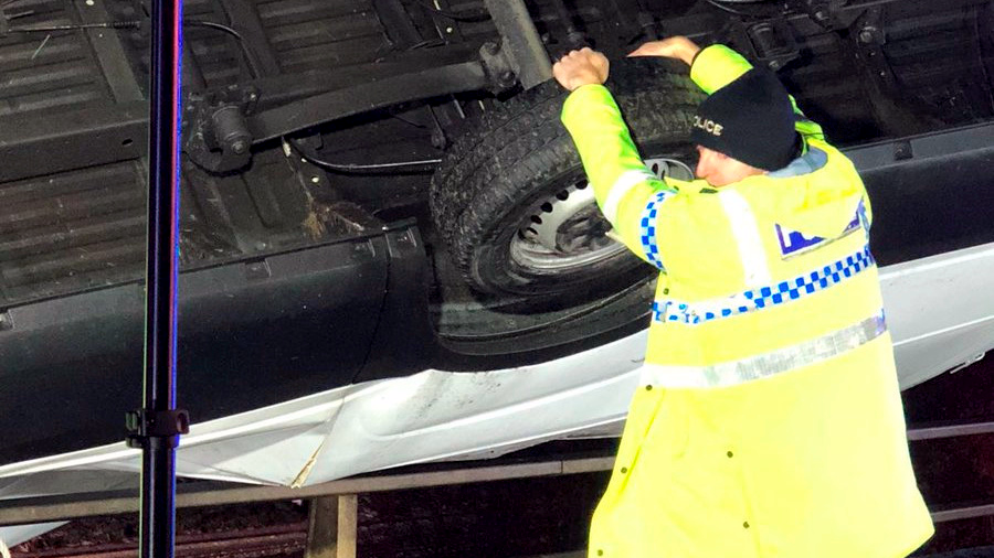 Police Officer Holds Car With His Bare Hands To Stop It Falling Off Motorway