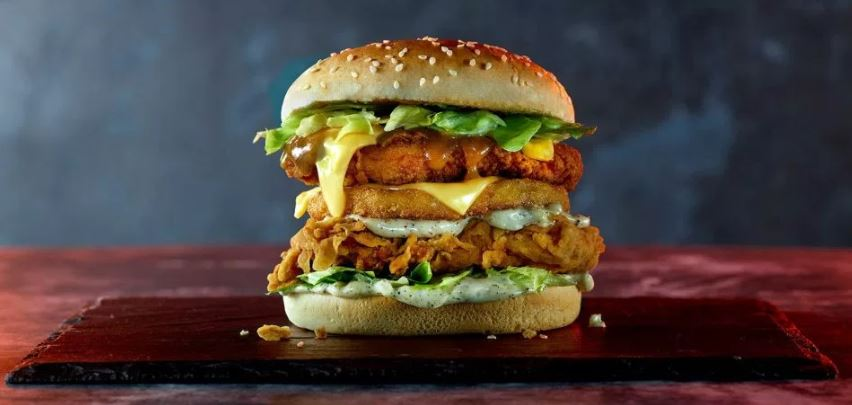 The Hacker Burger features a hash brown, chicken zinger fillet AND chicken fillet. Credit: KFC