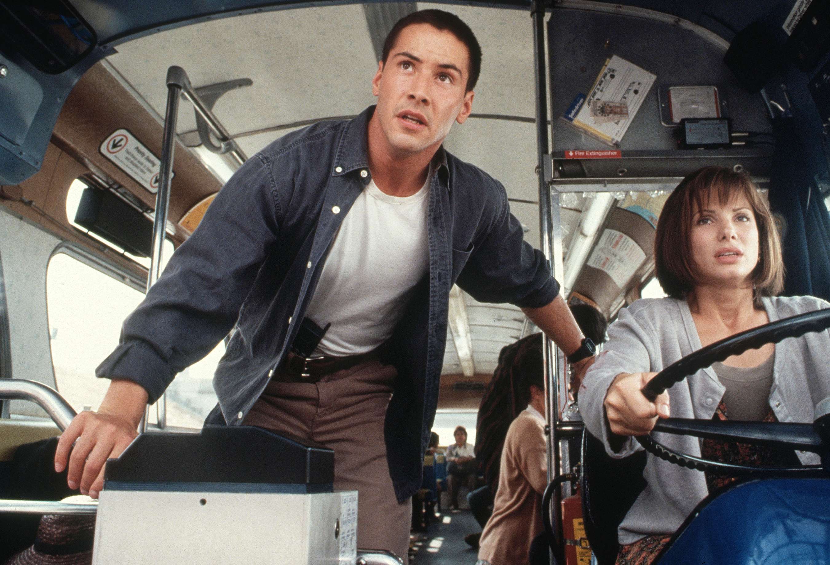 Reeves and Bullock in Speed. Credit: 20th Century Fox