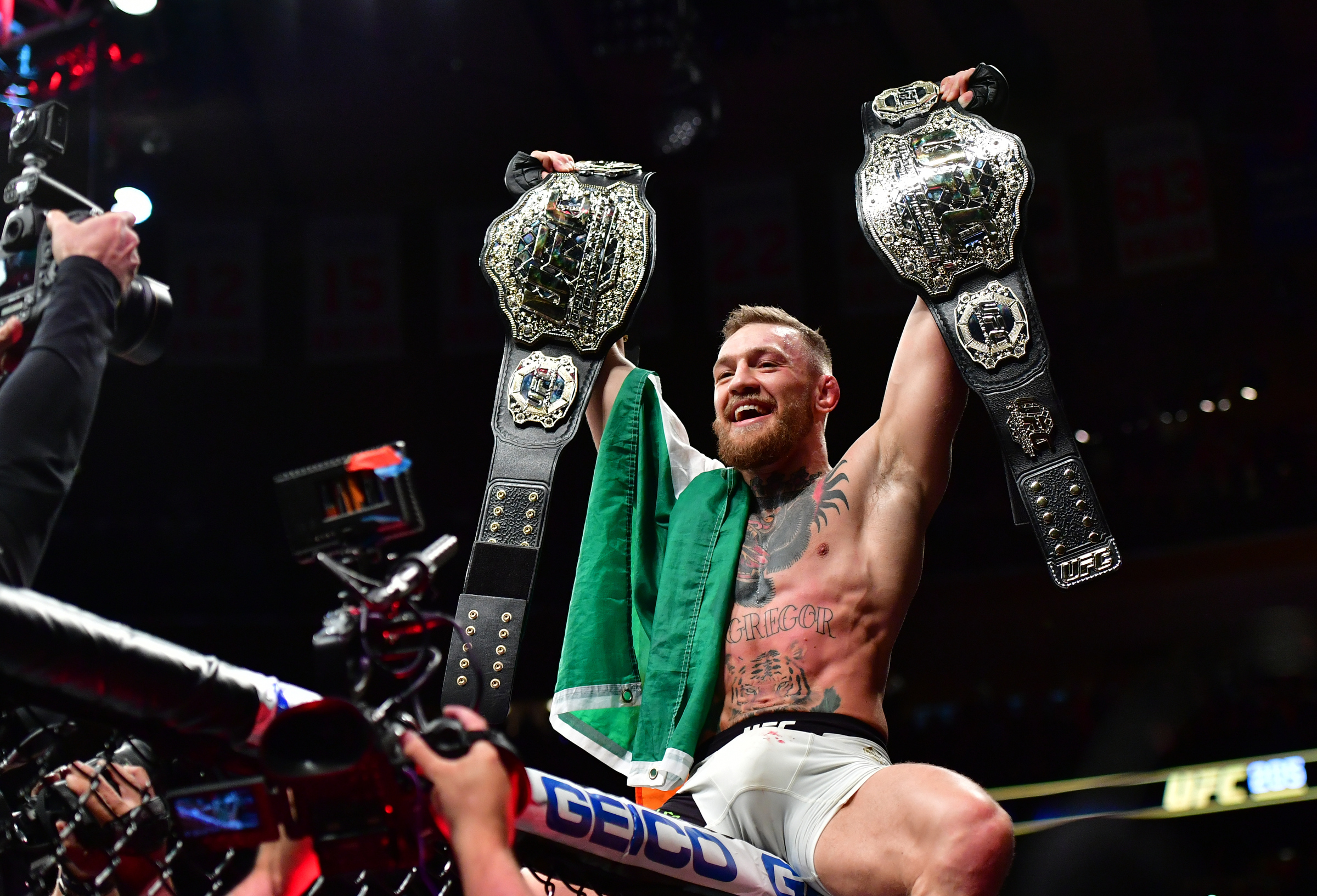 Conor McGregor jumps into cage and rows with referee