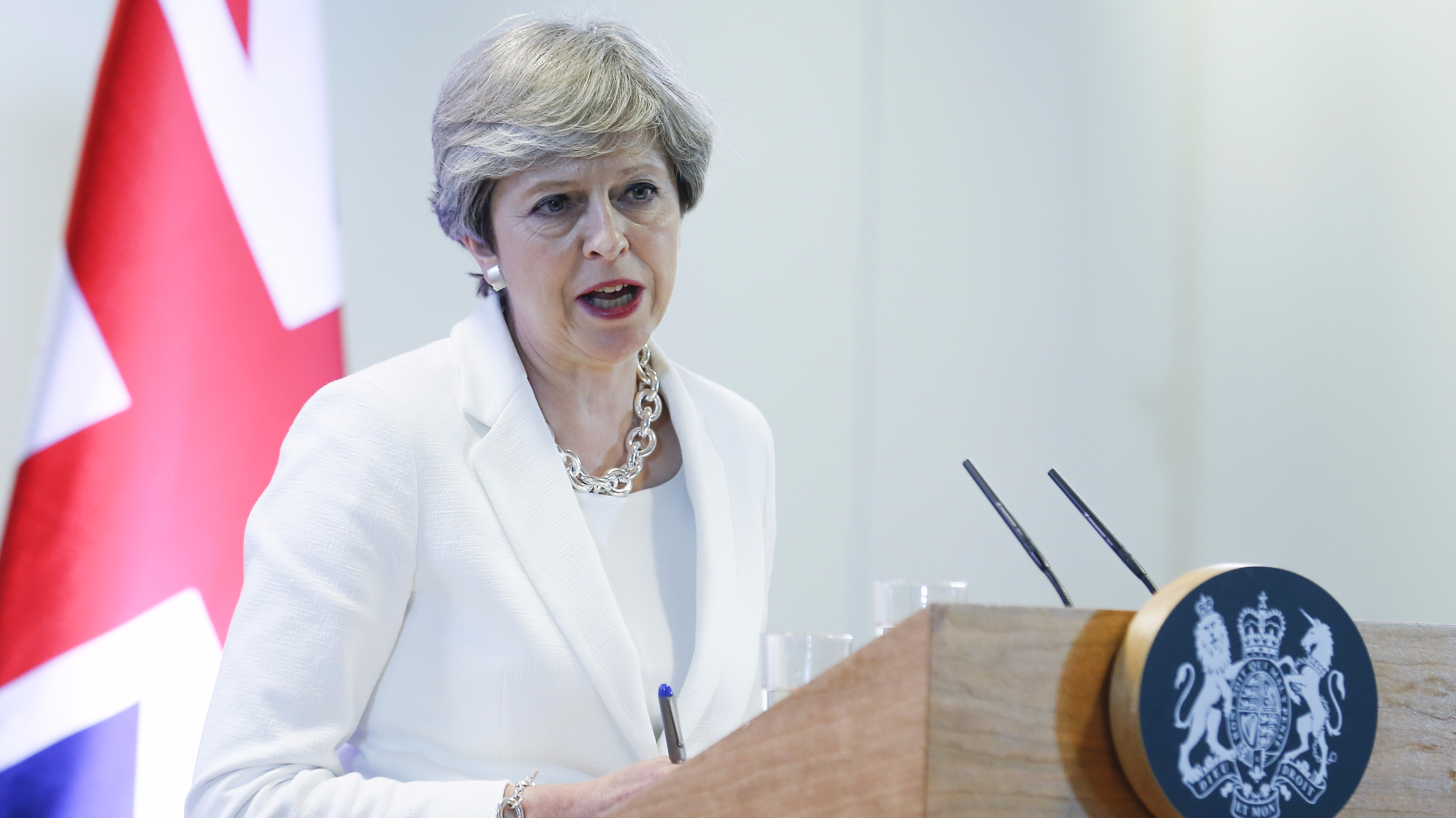 UK Prime Minister Theresa May attends a press conference in Brussels