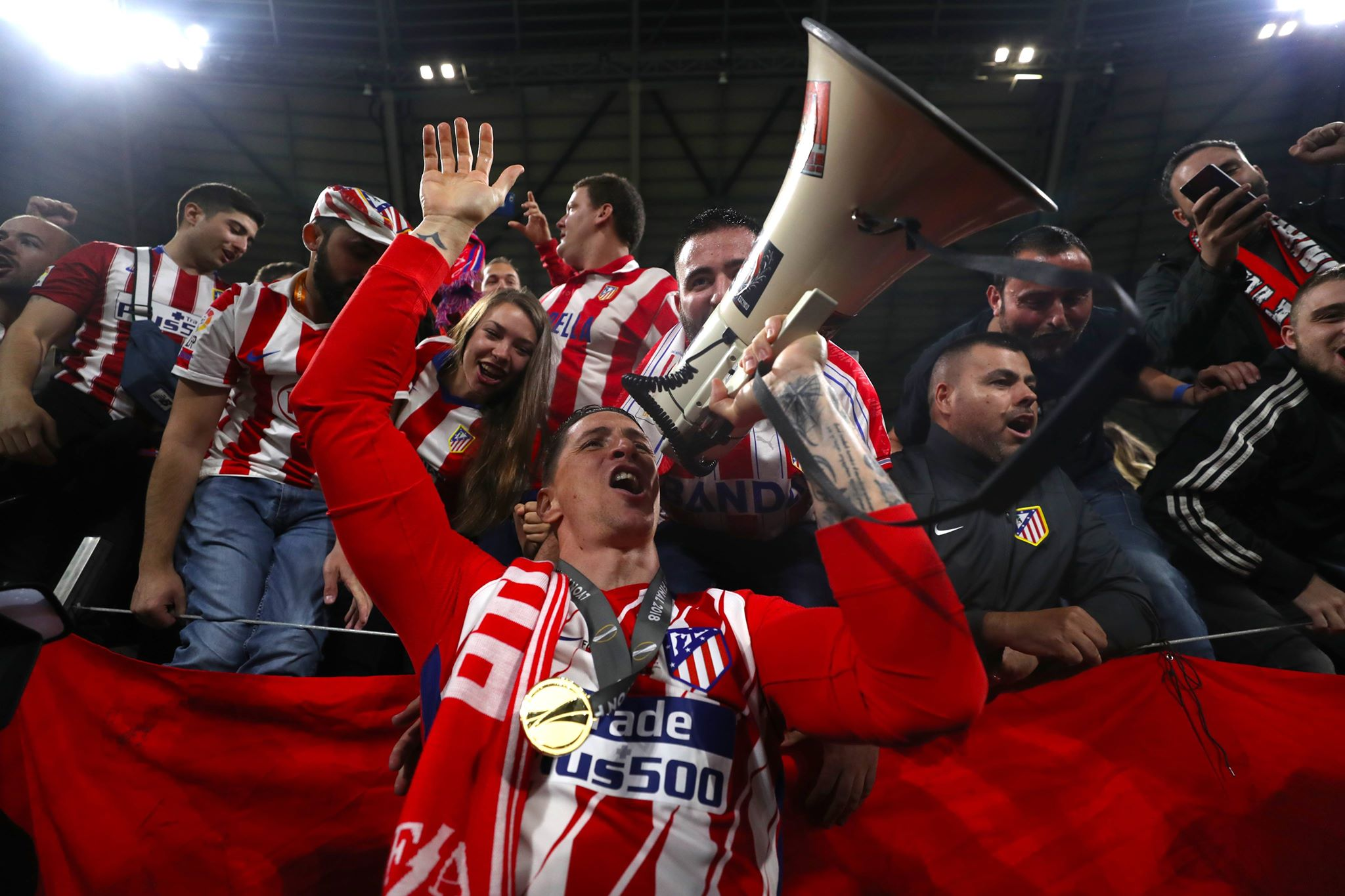 Torres celebrates with the fans. Image: PA