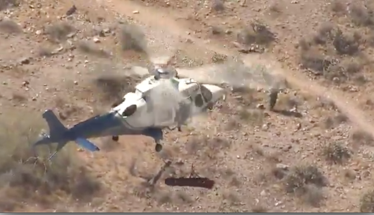 Hiker spins uncontrollably in one very unfortunate helicopter rescue