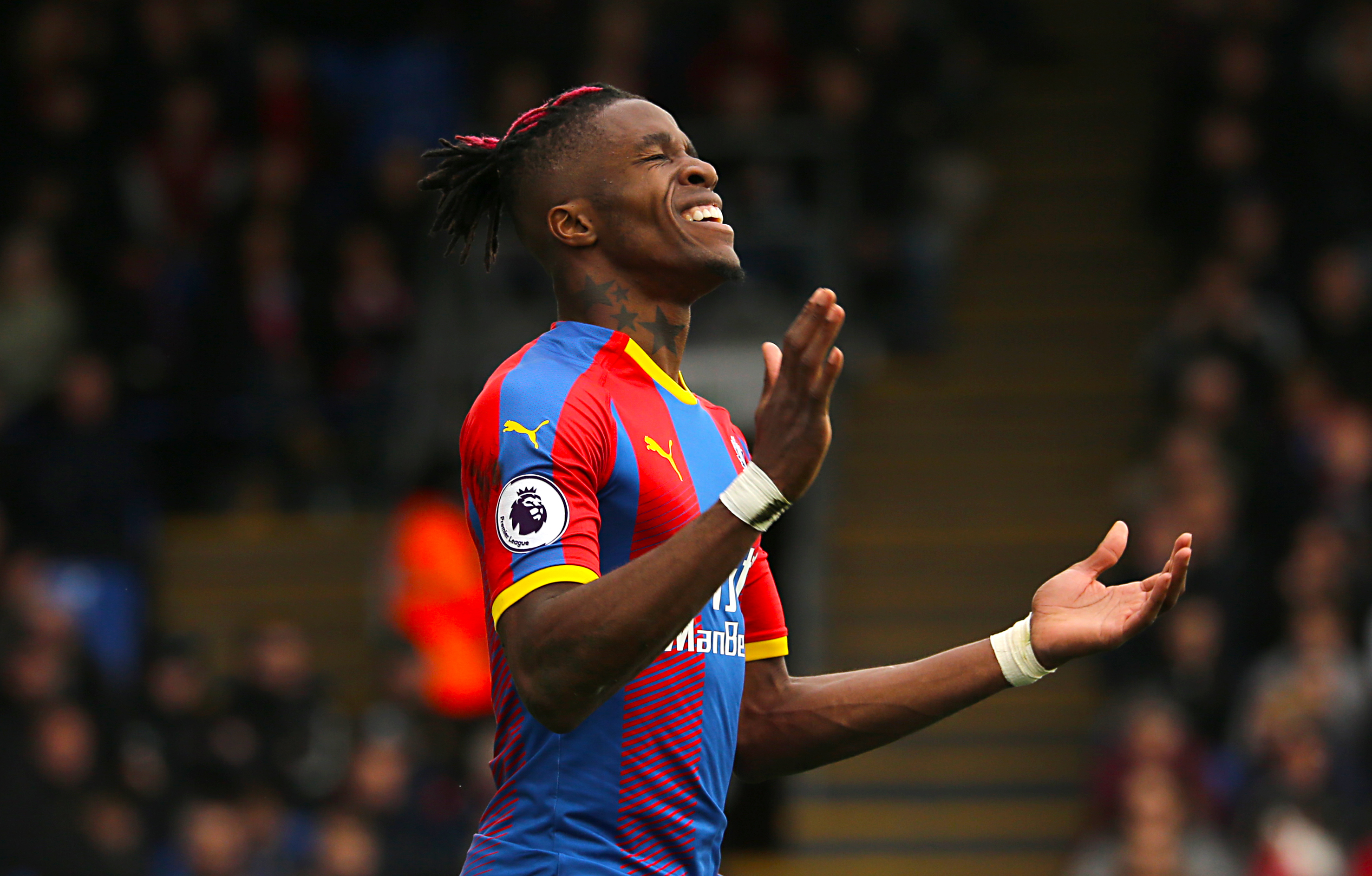 Wilfried Zaha: Winger 'committed' after staying, says Roy Hodgson