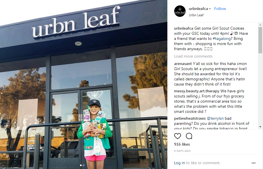 Girl Scout sells cookies in front of a weed dispensary