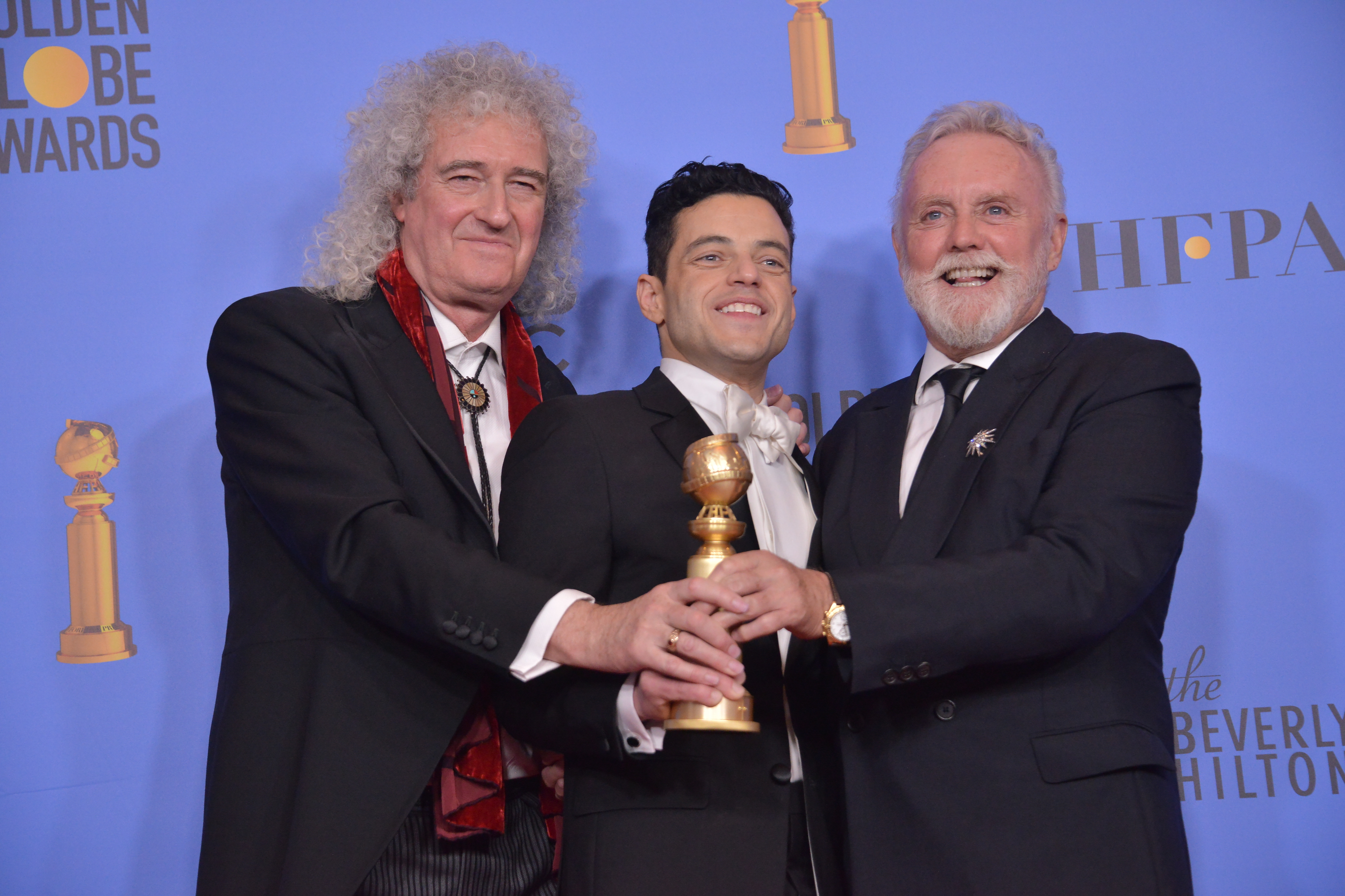 Roger Taylor and Brian May of Queen and Rami Malek at the Golden Globes. Credit: PA