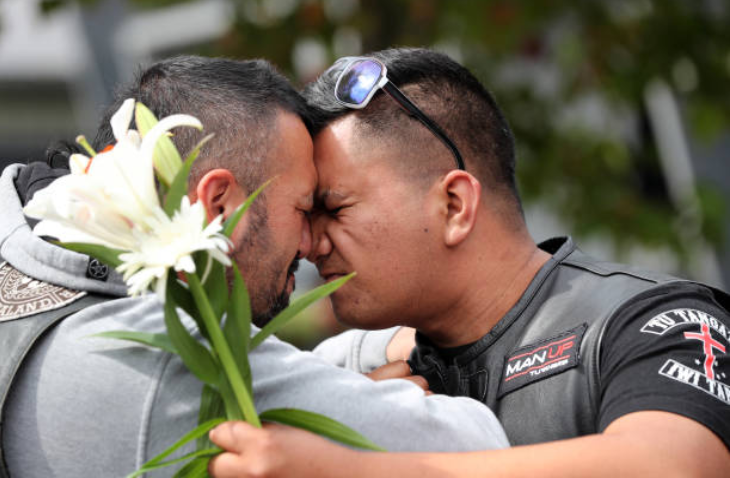 One gang member seen comforting man in New Zealand. Credit: Getty