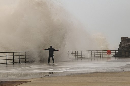The fella embraced the waves. Credit: Kennedy News and Media