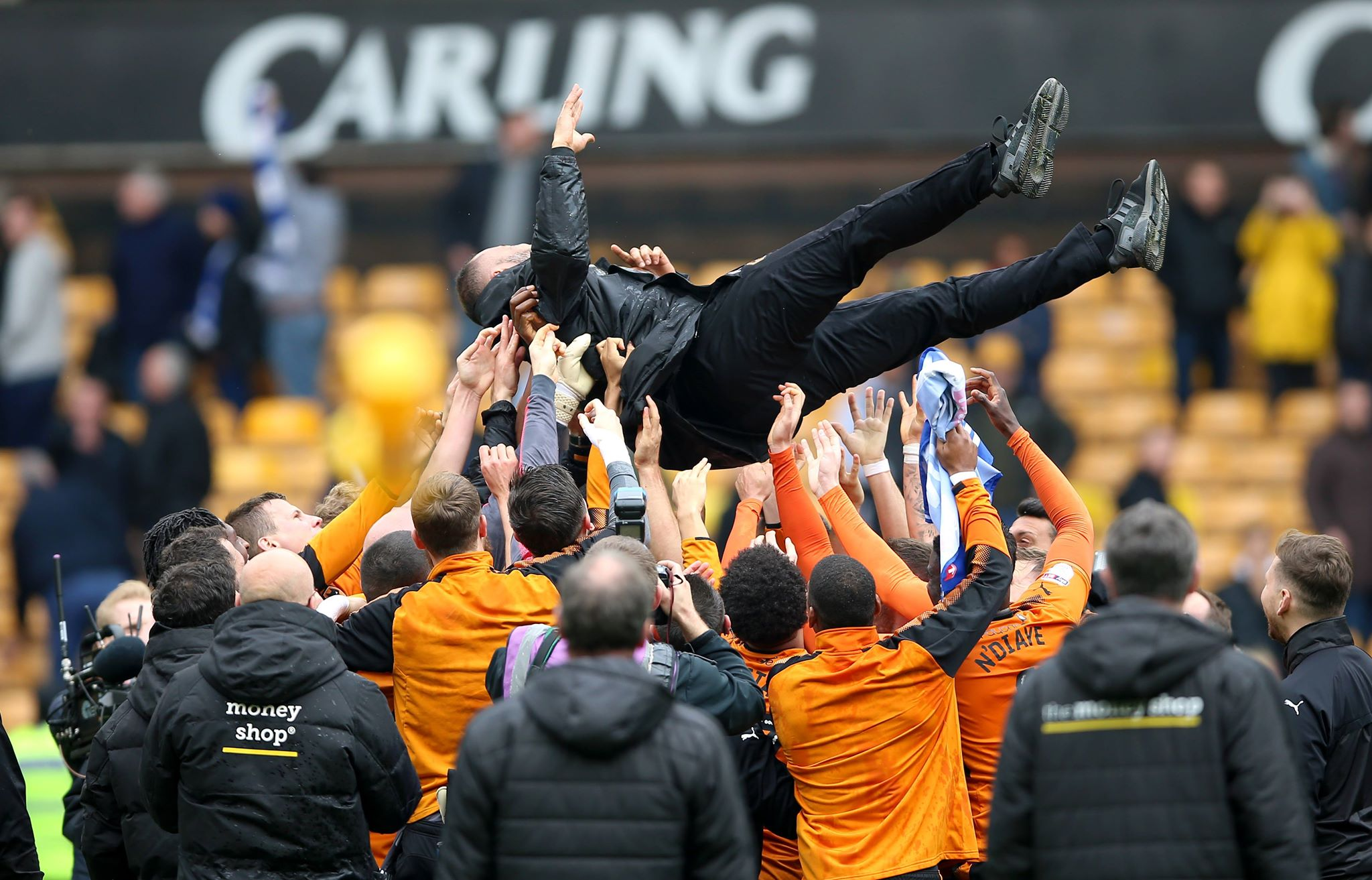 Wolves players hurl Nuno up in the air. Image: PA