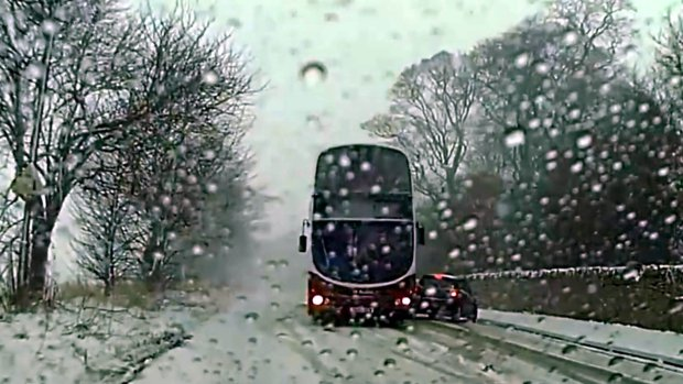 Brilliant Bus Driver Performs Perfect Skid To Avoid Crash In The Snow