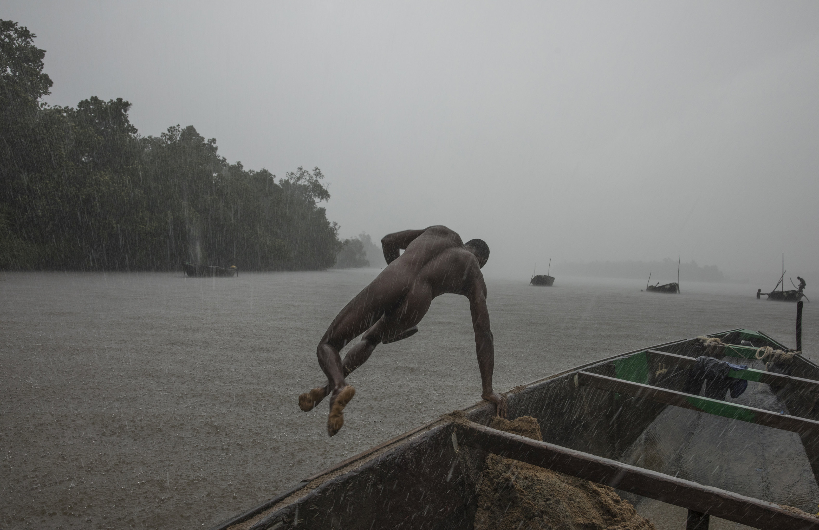 Some of the divers can't even swim properly and risk death to collect the sand. Credit: SWNS