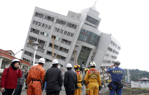 Workers survey the damage from the Taiwanese earthquake. Credit: PA