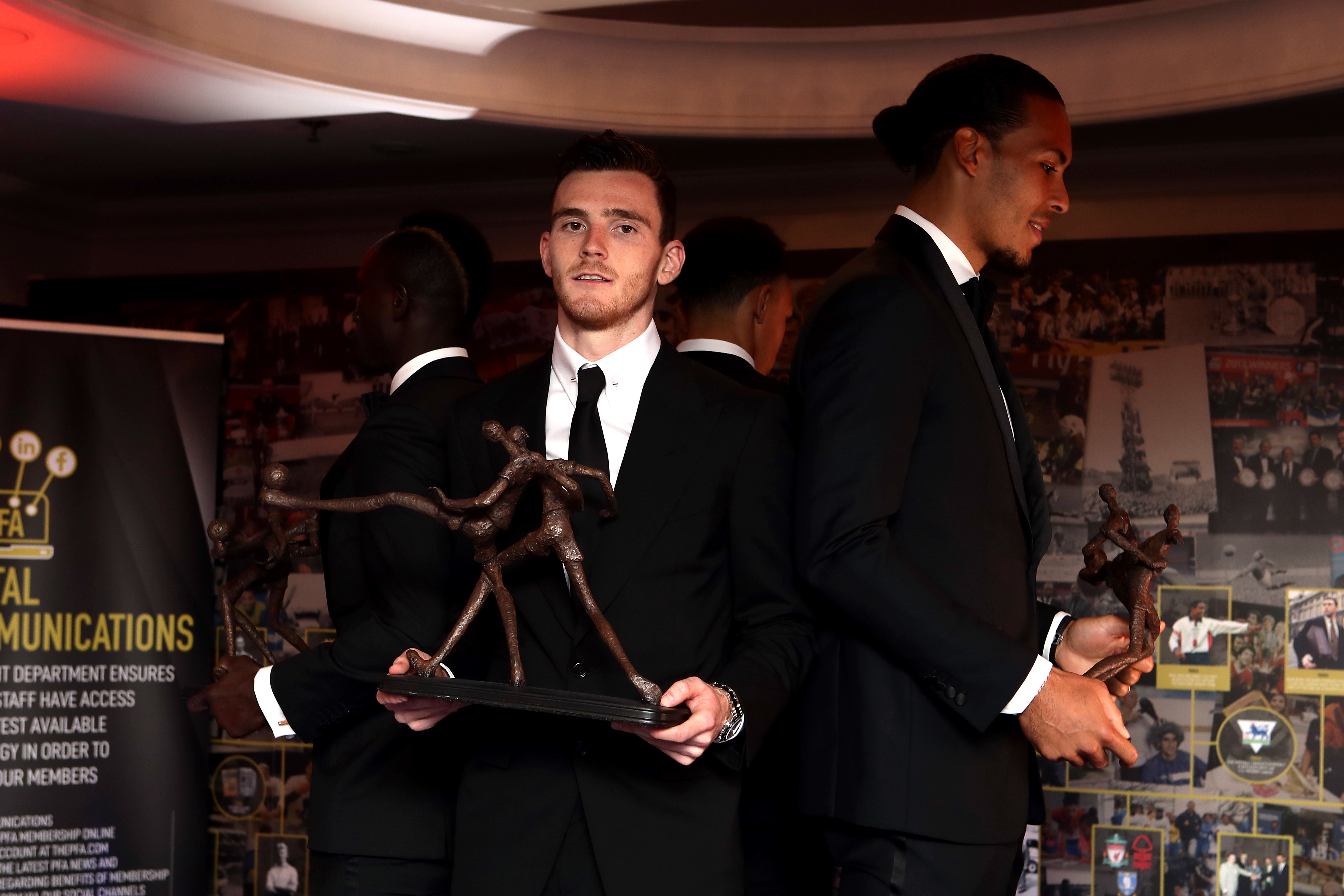 Andrew Robertson holds his award whilst Van Dijk holds the Player of the Year award. Image: PA Images