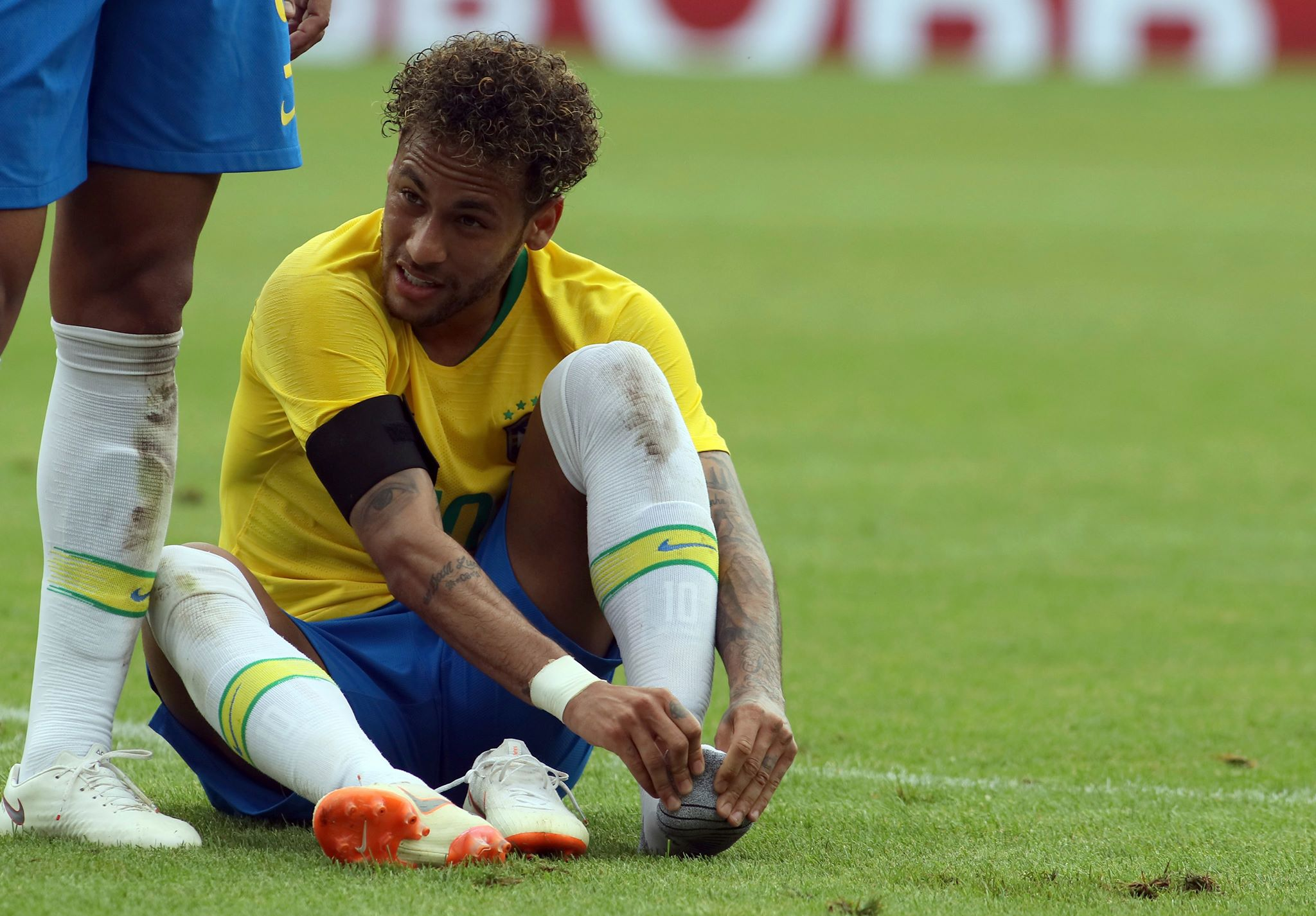 Neymar holds his foot. Image: PA