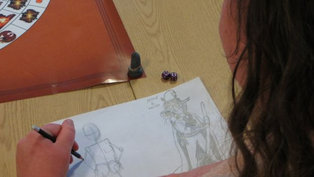 Player draws character in Billy Brown's new board game. Credit: BBC