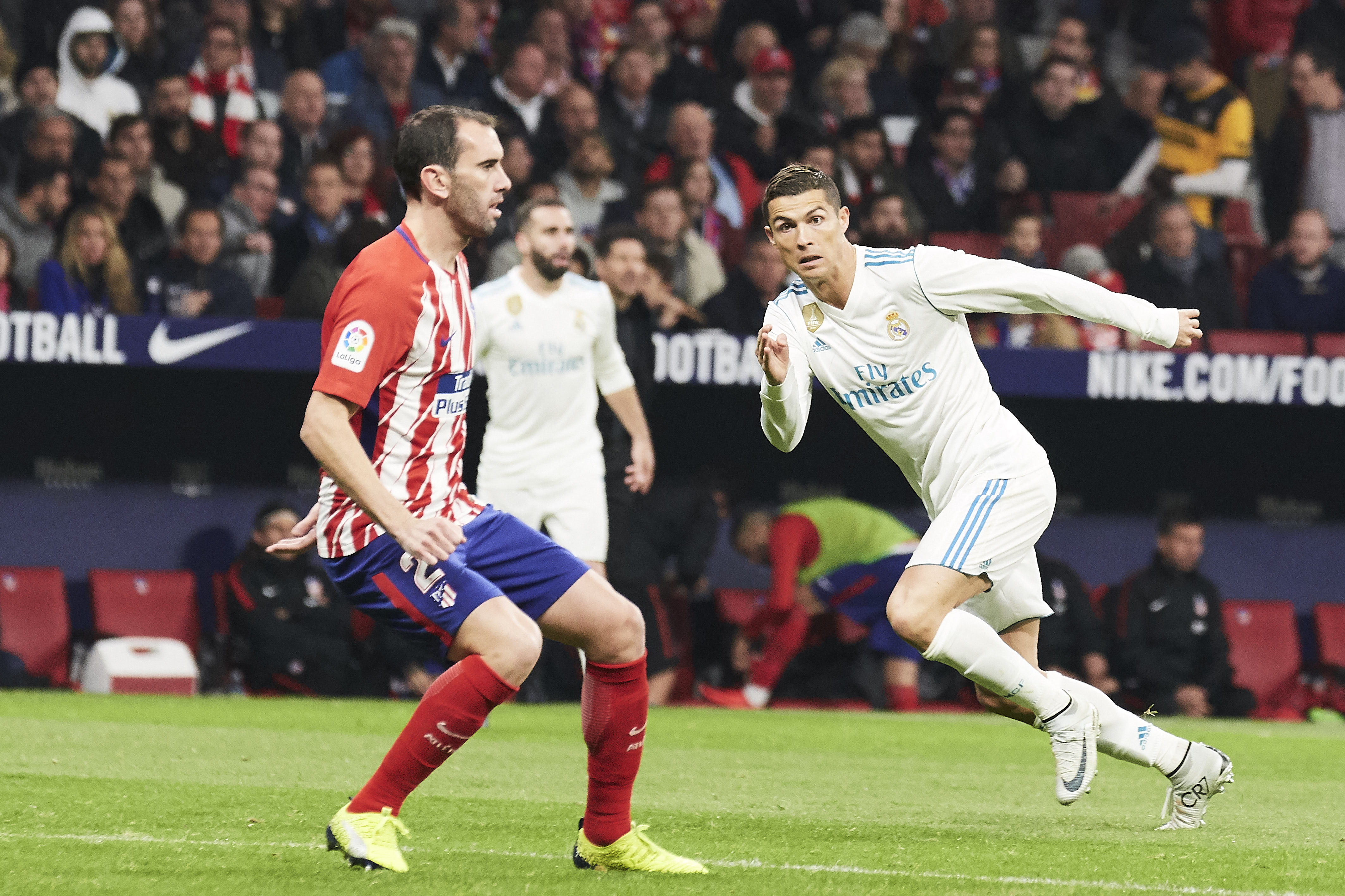 Godin and Ronaldo during the Madrid derby. Image: PA