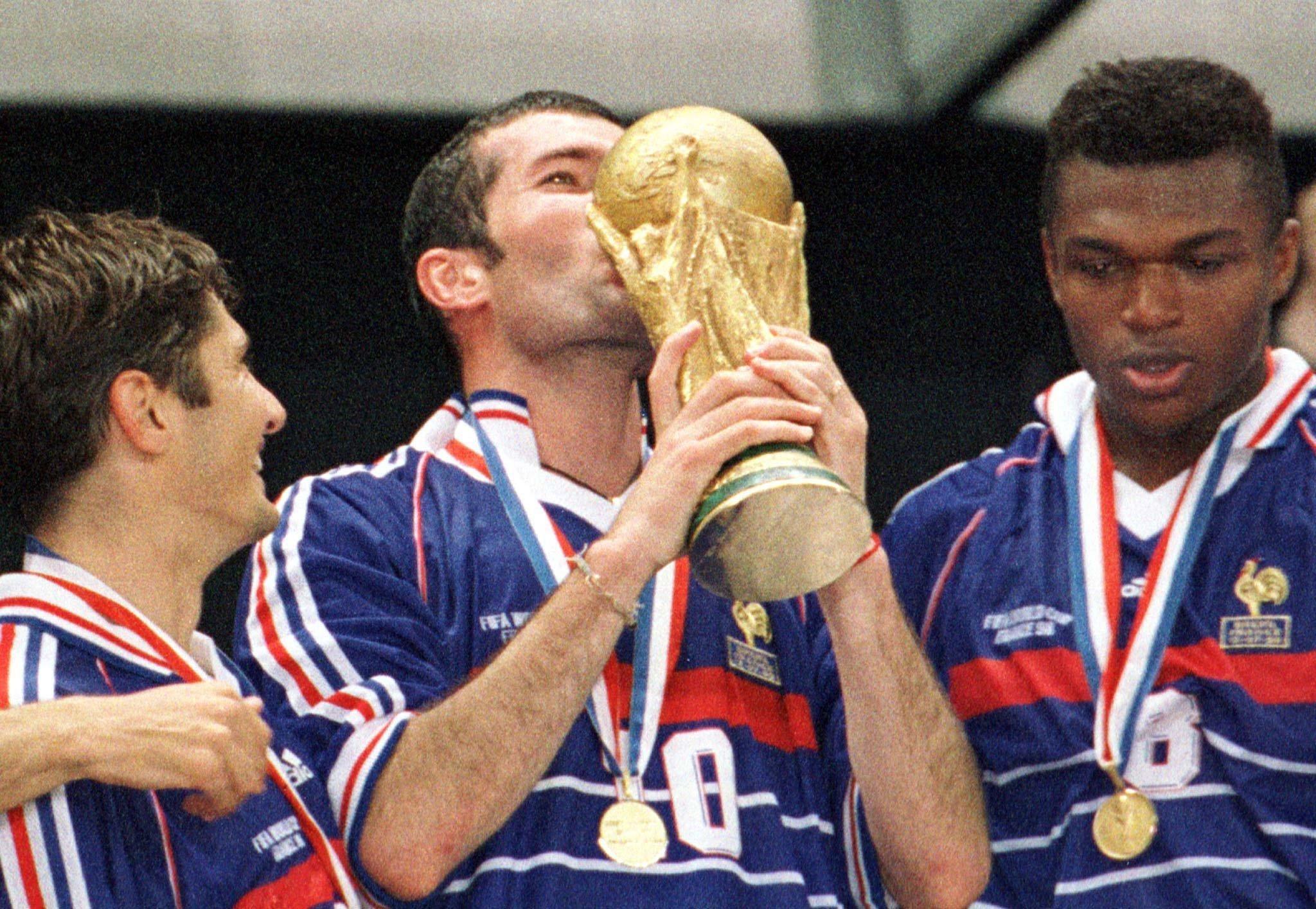 Zidane plants a kiss on the World Cup. Image: PA