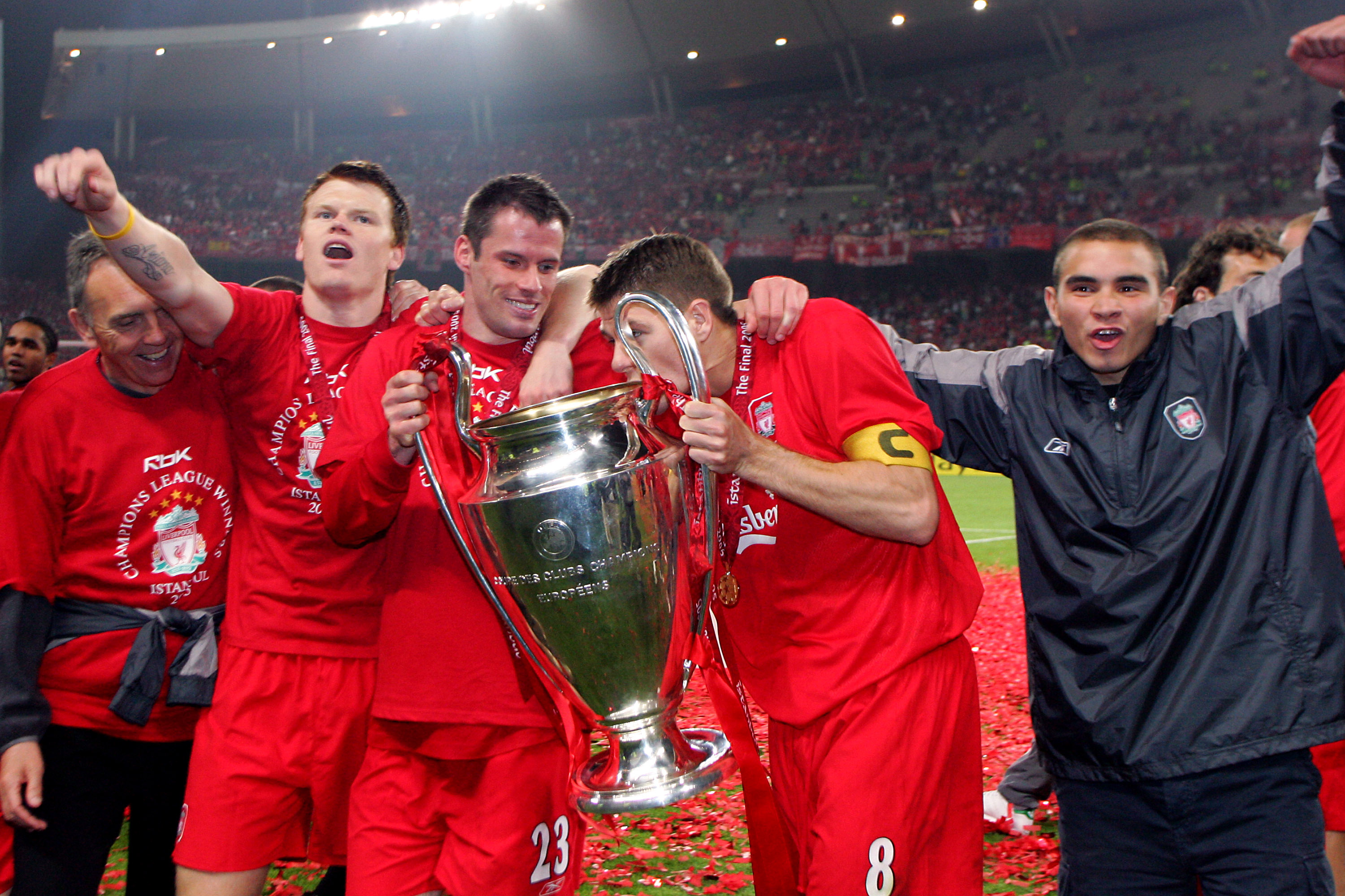 Riise celebrates the win with Carragher. Image: PA Images