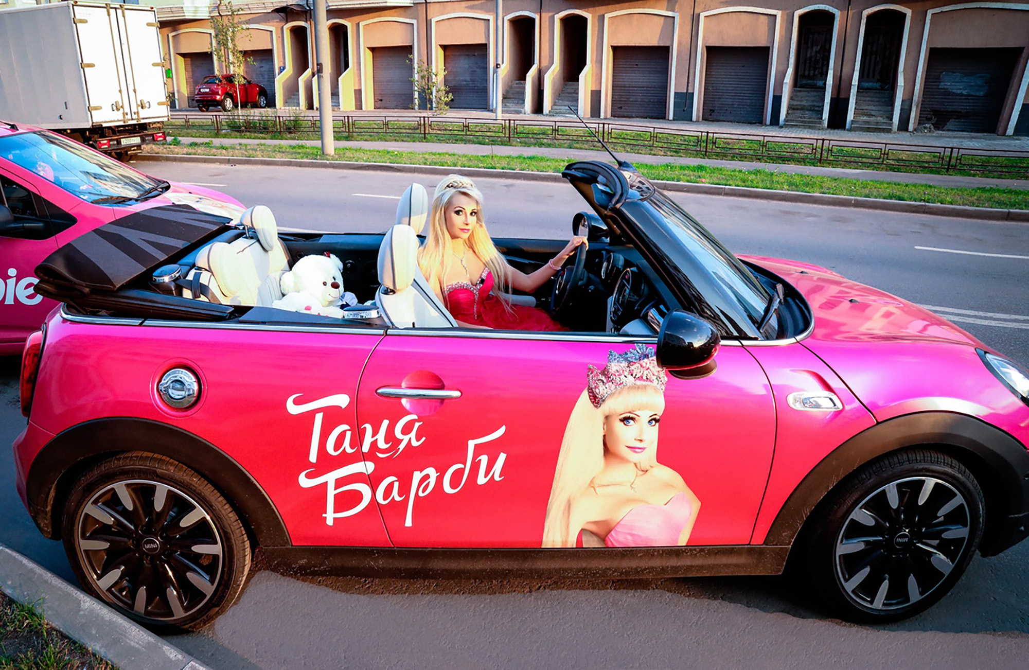 Tatiana driving her pink (obviously) Mini Cabrio. Credit: East2West News