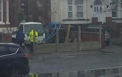 The workmen built a fence around their van. Credit: Facebook/Col Condron