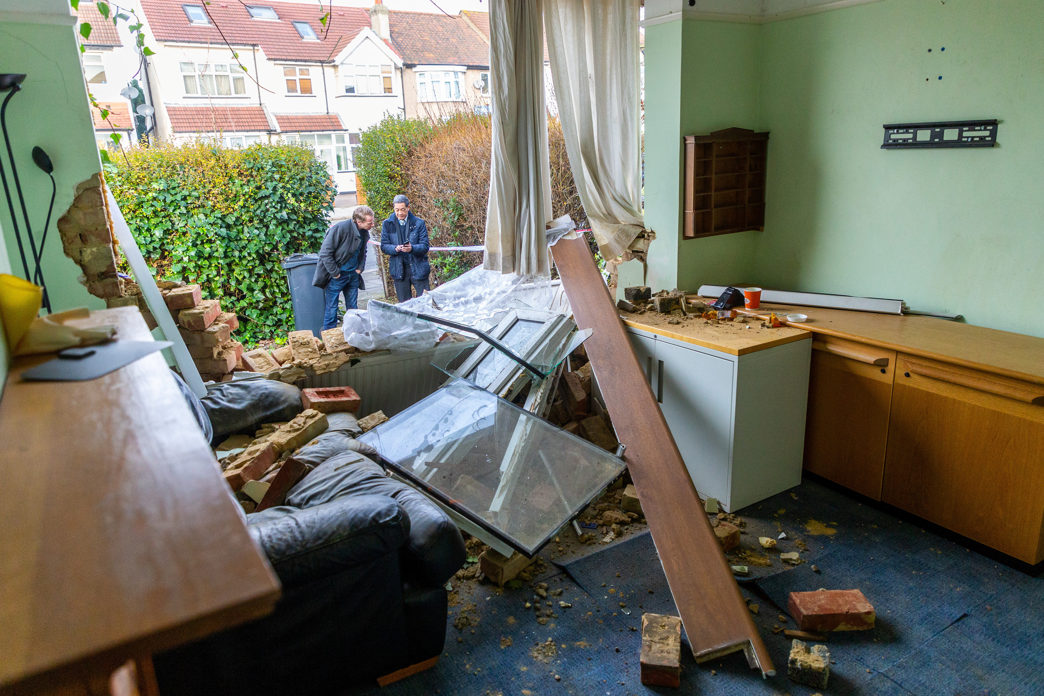 A house was left damaged in the incident. Credit SWNS