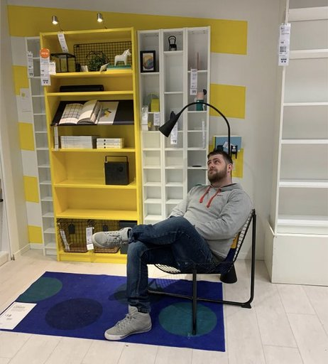 Is that a price tag on the empty bookshelf? And the other \*empty\* bookshelf... and the rug... and the other bookshelf. Hang on a minute. Credit: instagram.com/phoonigan