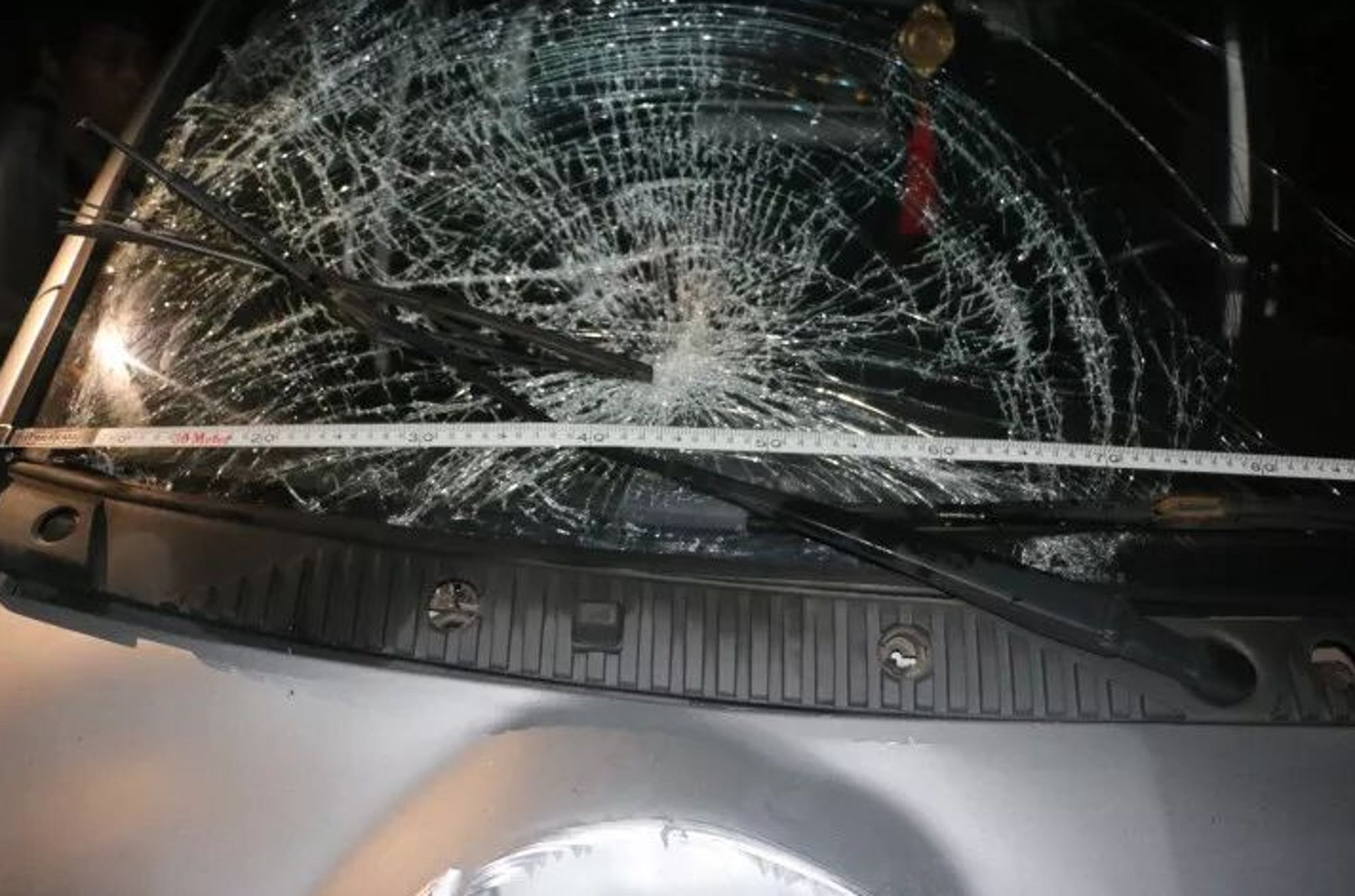 Damage to the car that struck the husband. Credit: AsiaWire
