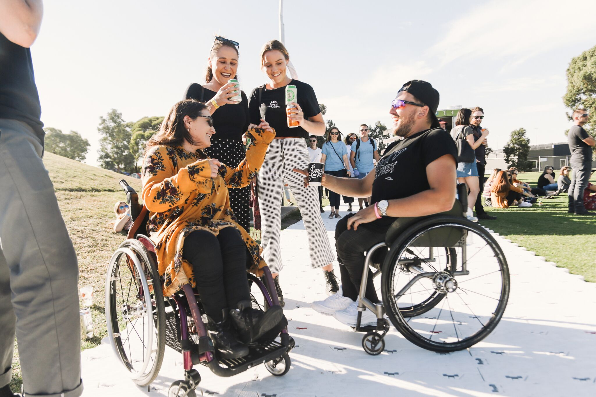 Dylan Alcott with festival goers. Credit: Alex Drewniak