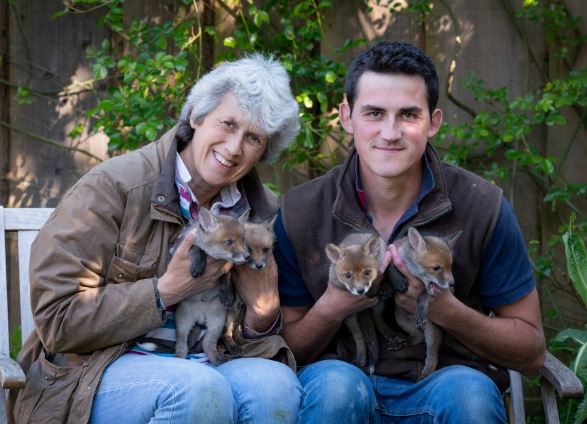 Farmer Chris Rolfe rescued the cubs and his mum Jean took over to help look after them. Credit: SWNS