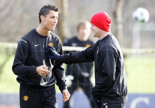 Ronaldo and Rooney during United training. Image: PA