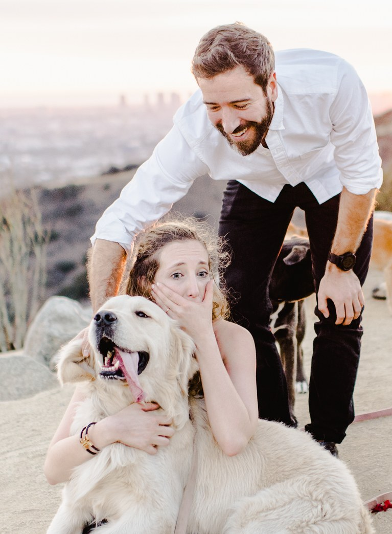 Just after Laura said yes she was greeted by 16 dogs. Credit: Rebecca Yale Photography/Laura Stampler