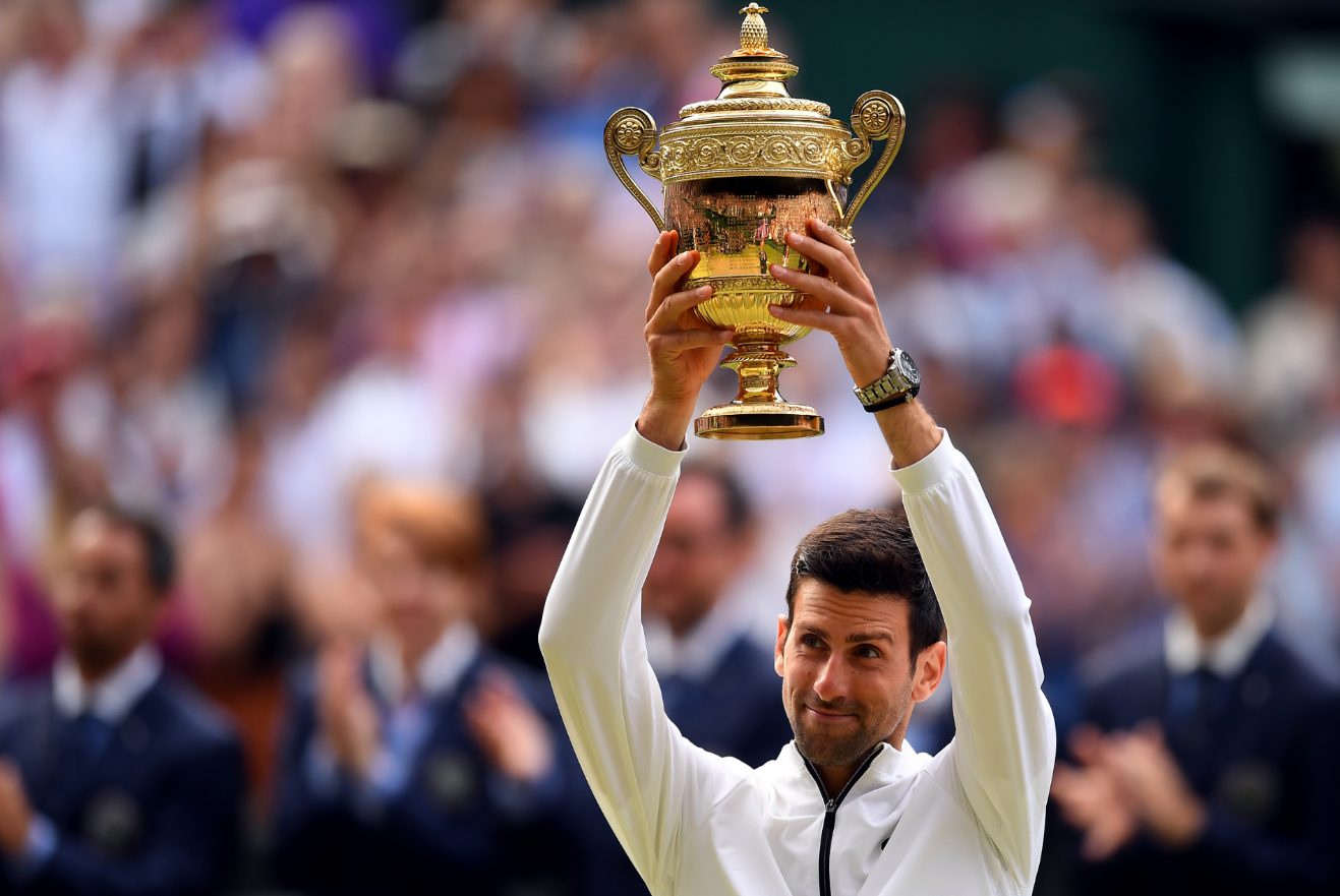 Novak Djokovic with his trophy. Credit PA