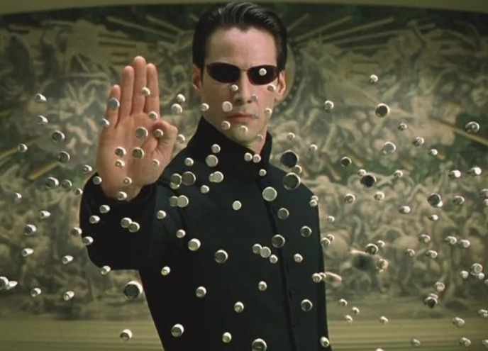 Reeves starred as Neo in the original three films. Credit: Warner Bros.