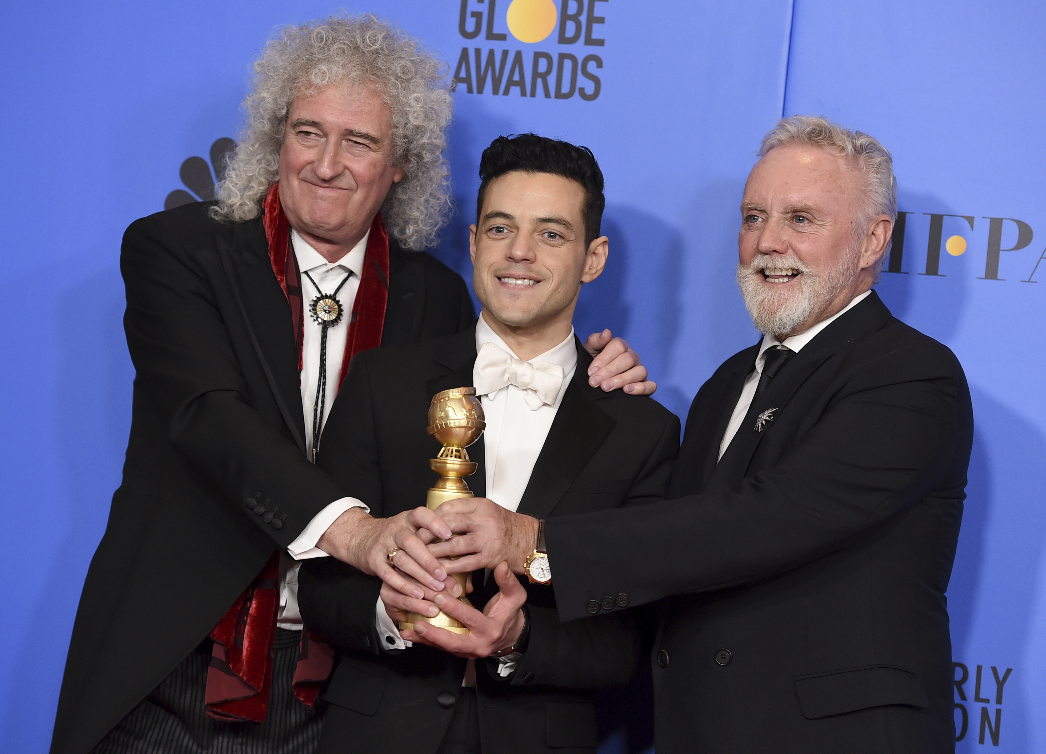 Queen guitarist Brian May, actor Rami Malek and drummer Roger Taylor. Credit: PA