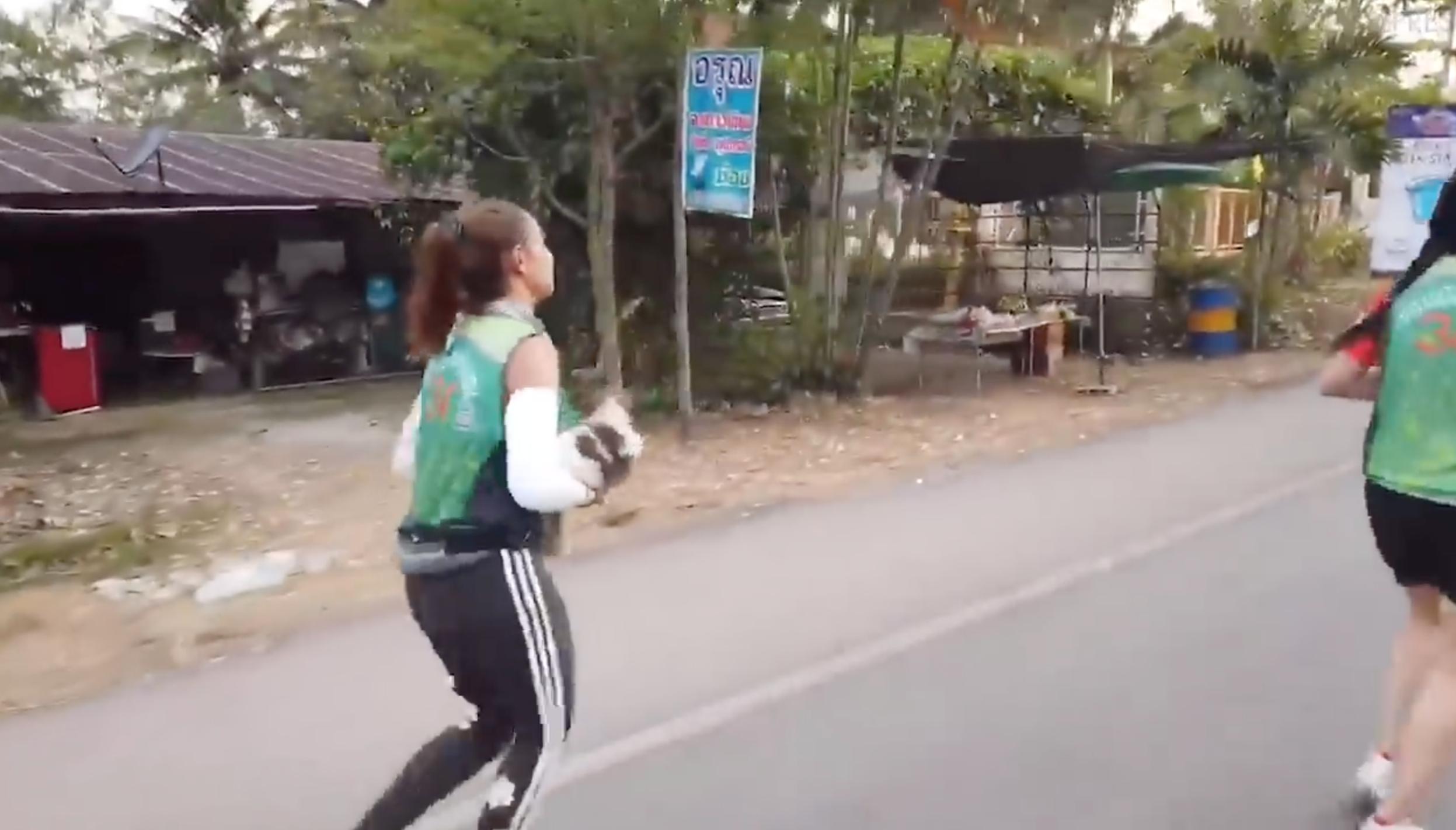 Klongsanun was early into a marathon in Ratchaburi, western Thailand. Credit: Viral Press