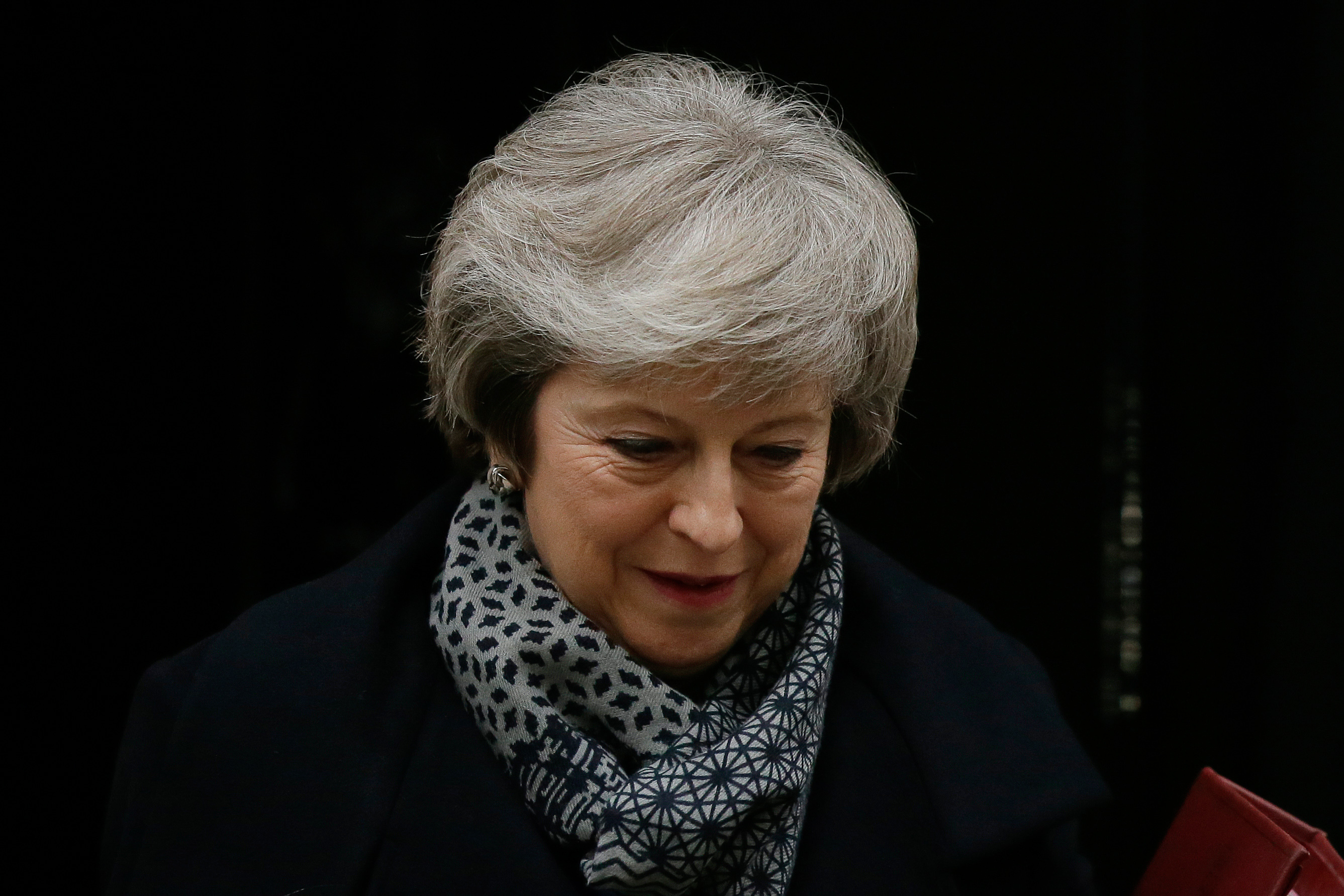 PM promises cross-party talks after her Brexit plans suffer historic defeat