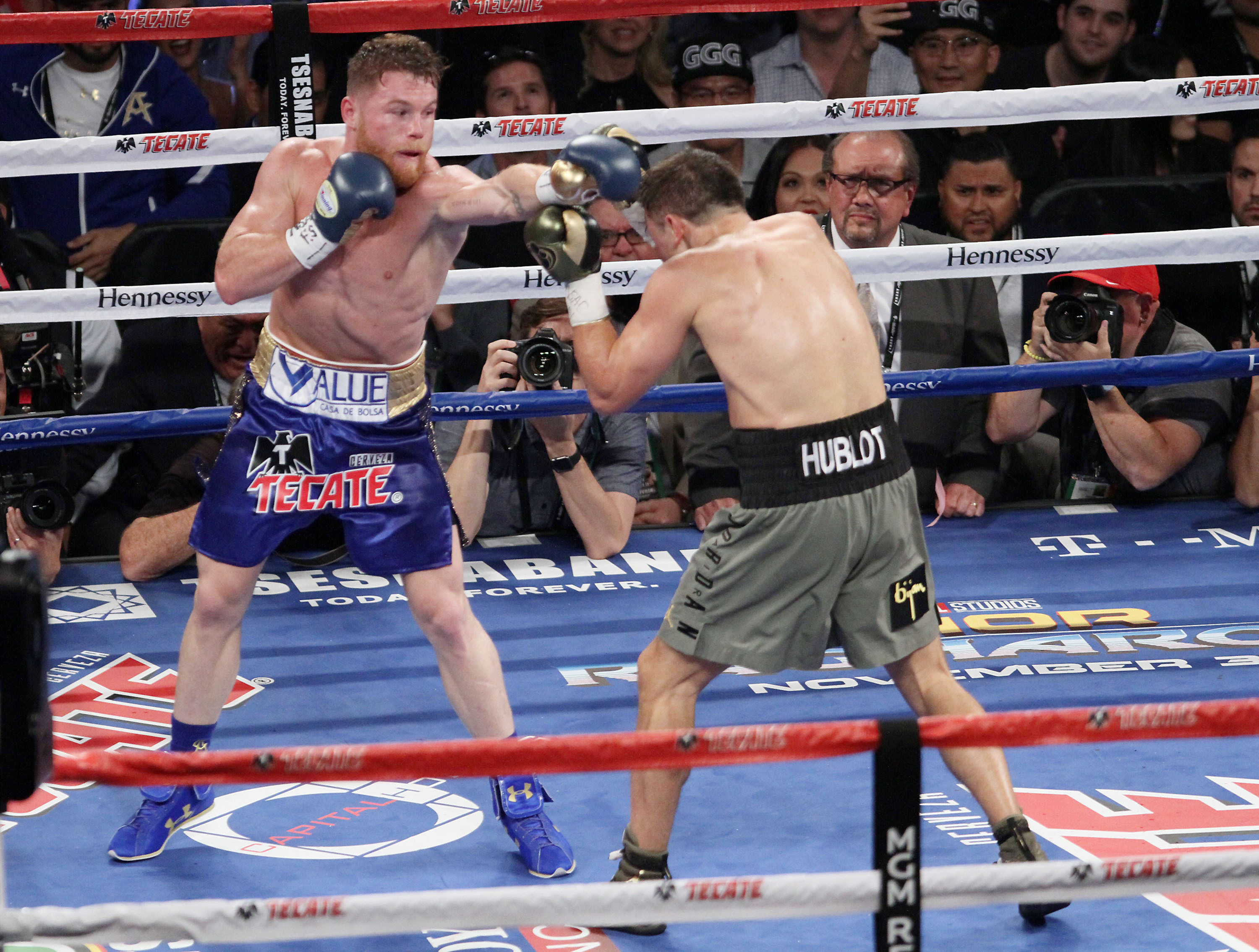 'Canelo' and 'GGG' in action. Image: PA