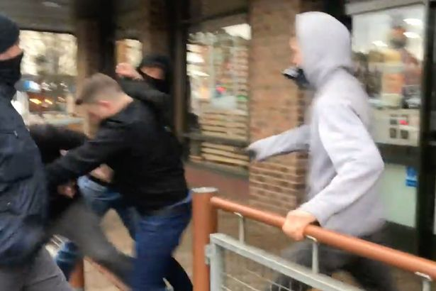 Tommy Robinson 'ATTACKED' by 'far-left extremists' outside McDonald's in Harringay, London