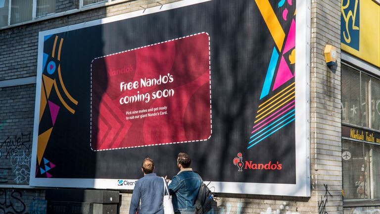 You'll need to rip one of these giant loyalty cards off a billboard. Credit: Nando's