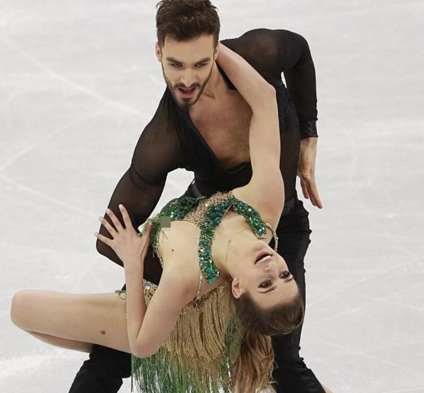 Ice skating boob slip