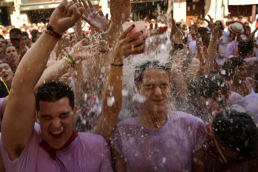 Revellers celebrate the official opening of the 2019 San Fermin fiestas in Pamplona. Credit: PA