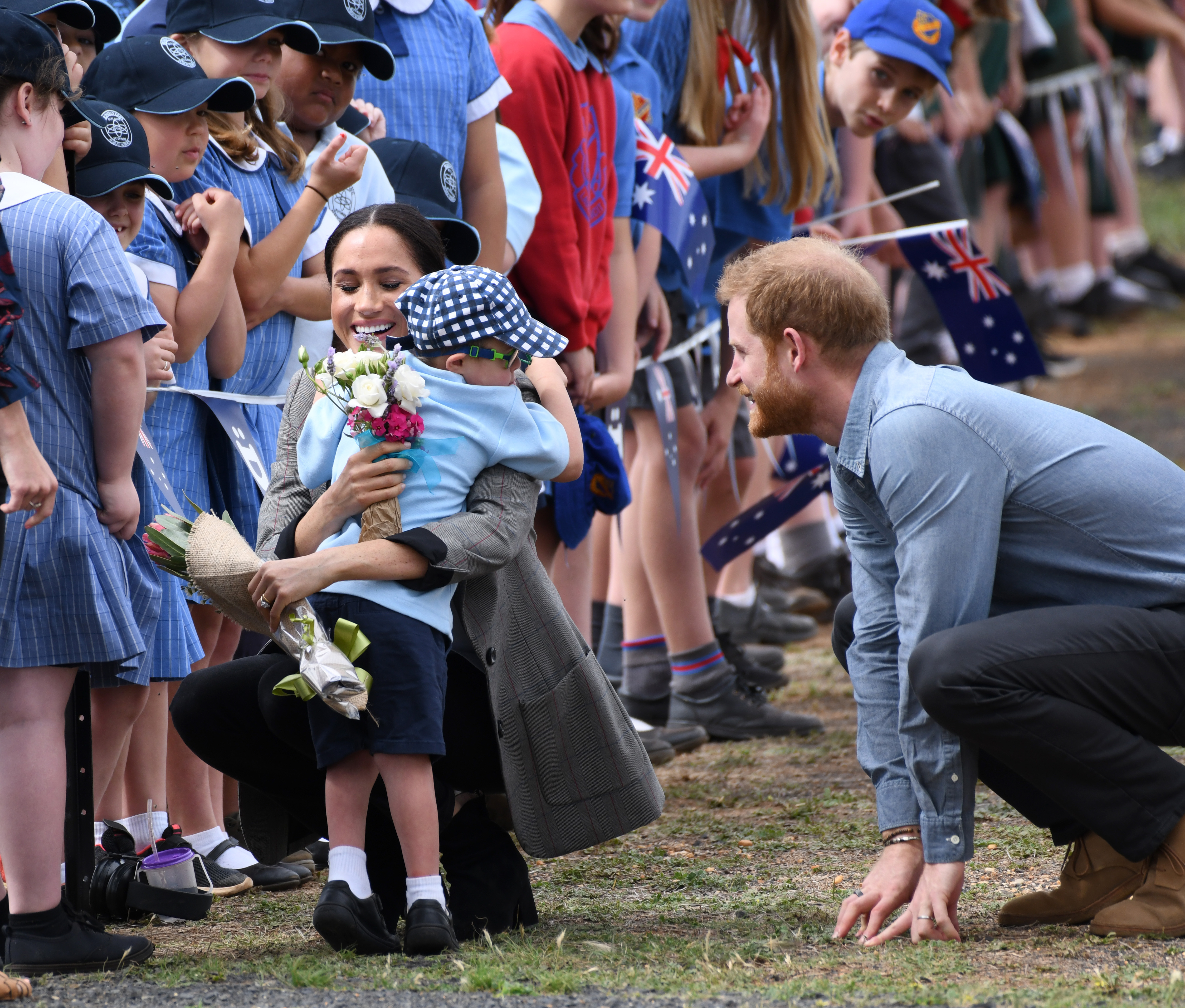 Prince Harry gets newspaper credit for photo of Meghan Markle with lookalike