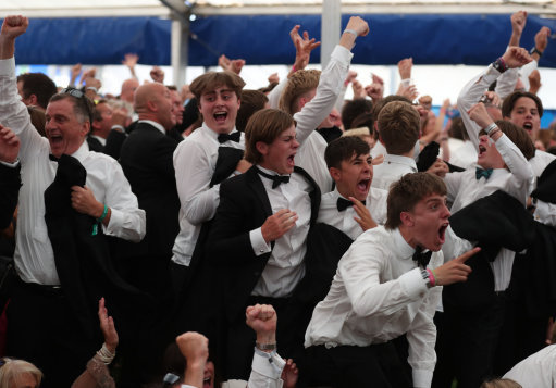 Fans at the Henley Festival celebrate England's goal from Keiran Trippier. Credit: PA