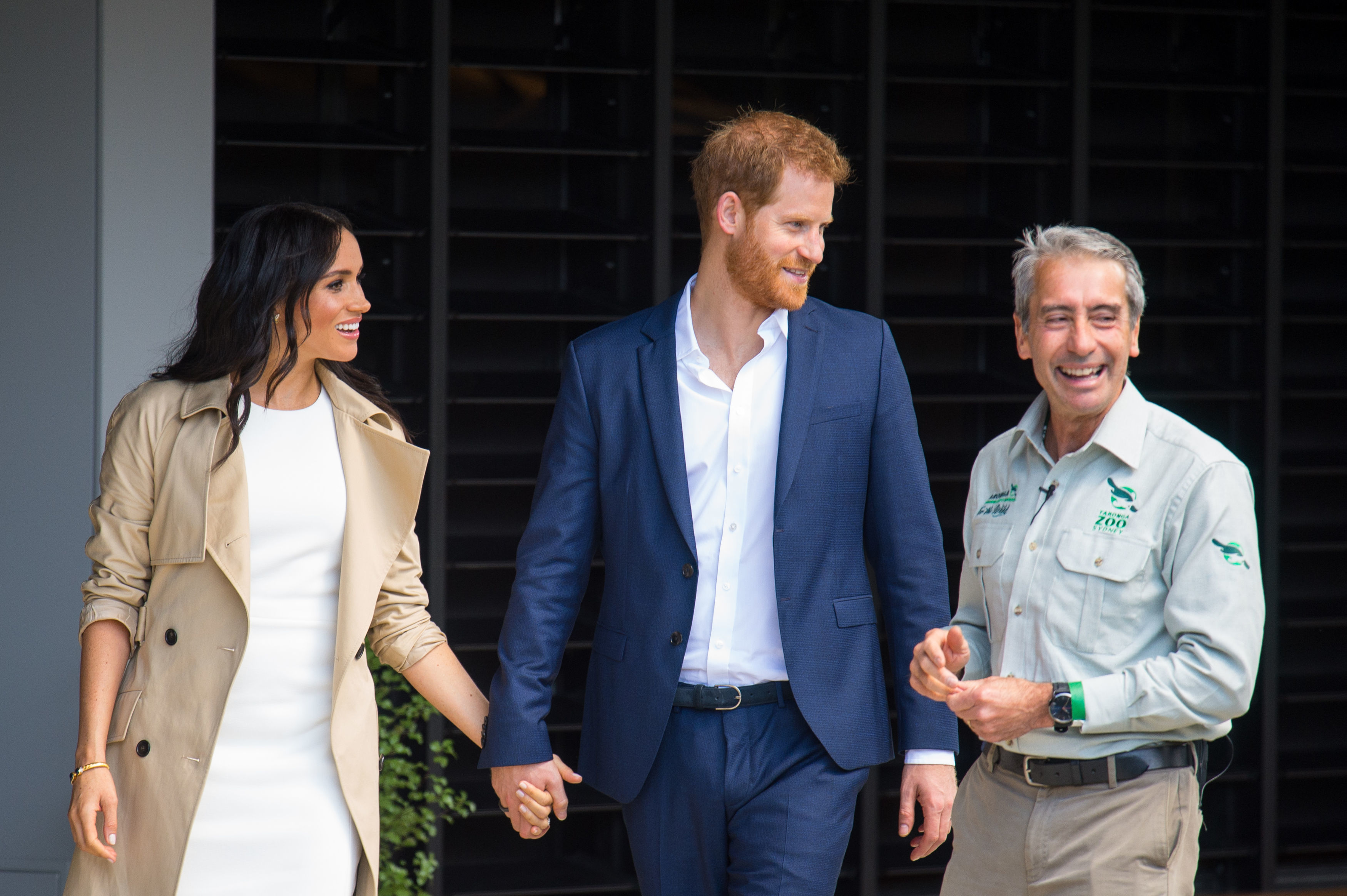 Prince Harry 'scolds' man giving Meghan huge flower bouquet