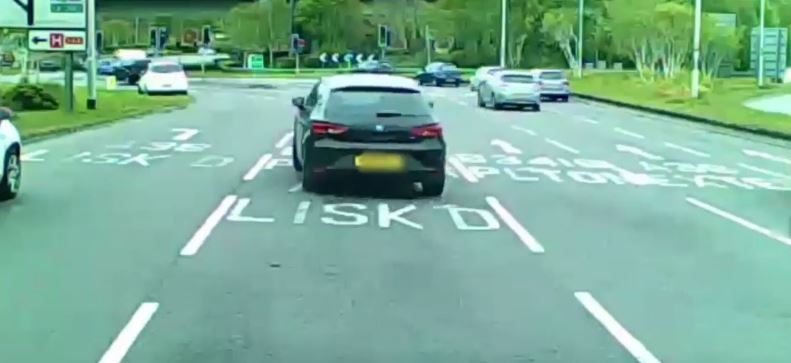 After ramming the other car a few times, the driver of the black Seat leaves the scene. Credit: SWNS