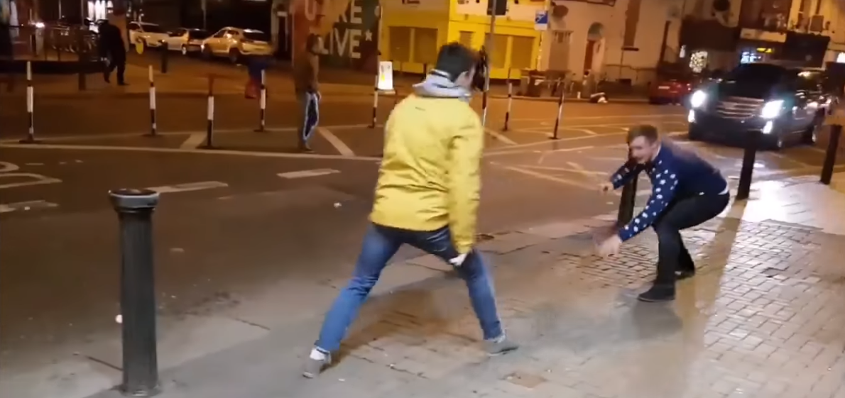 Two lads imitate McGregor.