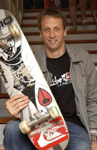 The World's Number one skateboarder Tony Hawk signs autographs for fans. Credit: PA
