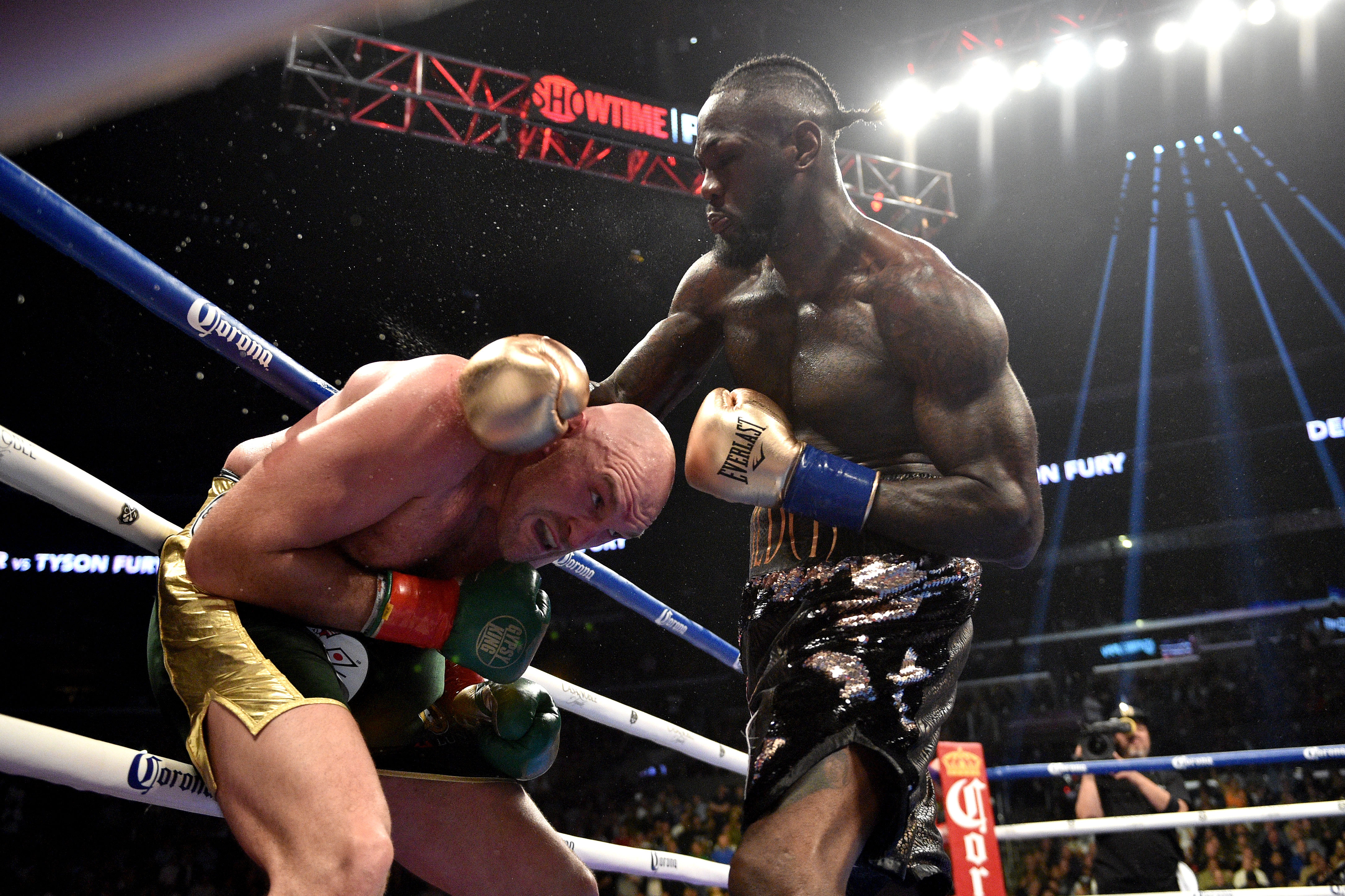 Tyson Fury gets whacked Deontay Wilder. Credit: PA