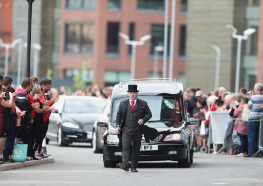 Paul Chuckle in tears as he carries brother Barry's coffin at funeral
