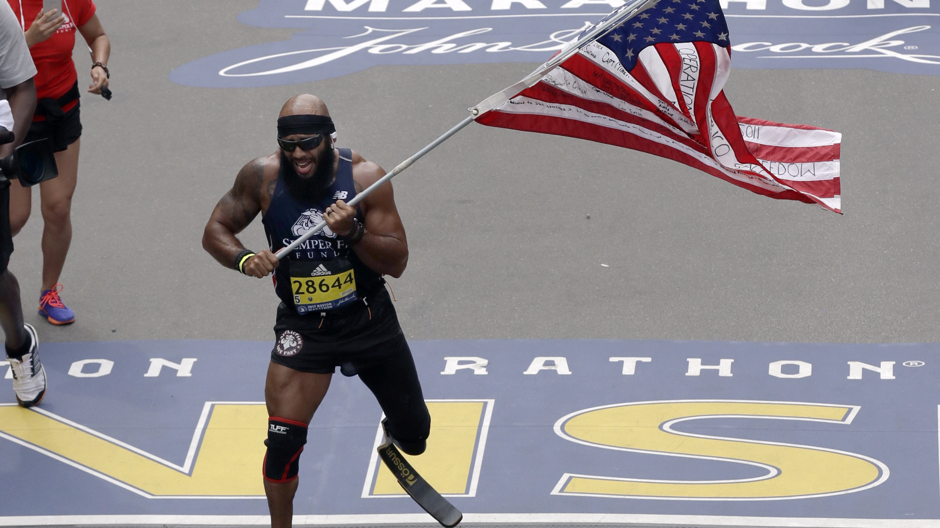 Amputee Marine Completes The Boston Marathon With Massive American Flag